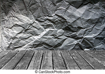 wood table on crumpled paper backgrounds