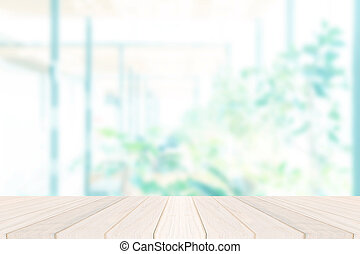 Wood table top on blur window glass,wall background with garden view.For montage product display or design key visual layout