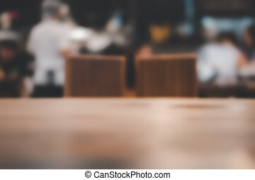 Wood table top with abstract blurred Japanese restaurant.