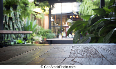 wood table with blur interior decoration style garden background