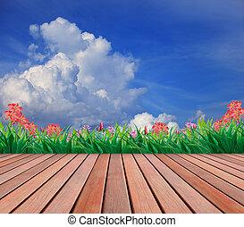 wood terrace and flower garden