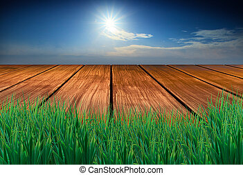 wood terrace with green grass fore ground sun blue sky background for multipurpose