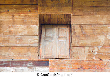 wood texture background from the wall of house in asia with vintage window in the middle