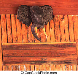 wood texture with carved elephant head