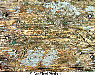 Wood texture with nails and remains of cracked paint