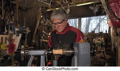 wood turner cutting shapes in wood - hands shape the...