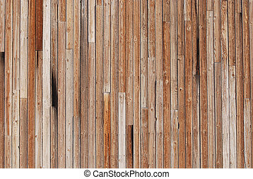 Wood  - Vertical wood strips on the side of a barn.