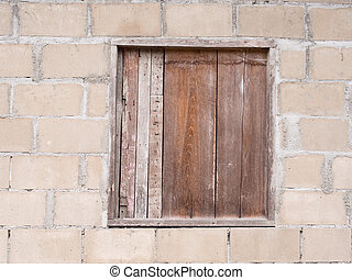 wood window on brick wall