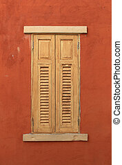 wood window on red wall