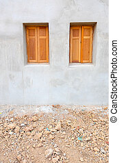 wood window on the cement wall