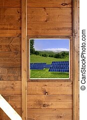 wood window solar plates meadow view