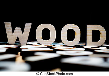 WOOD word made of wooden letters against dark background
