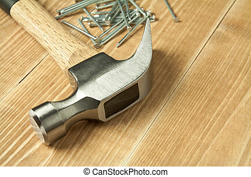 Wood working - Wooden planks, hammer and nails.