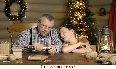 Woodcarving - Grandfather with grandson sculpting wood...