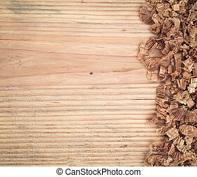 woodchips on old wooden fir board background