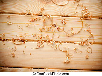 Woodchips shavings on wooden surface close up - Woodchips...