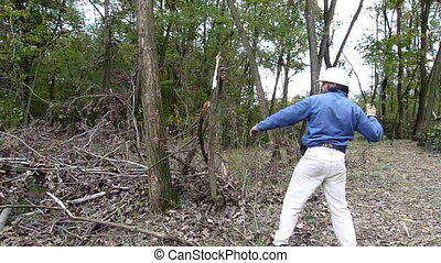 woodcutter - lumberjack with a machete working in a forest