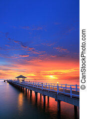 Wooded bridge in the beach island port between sunrise.