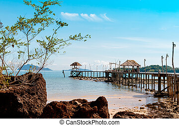 Wooded bridge to the sea between sunrise at Koh Kood, Trat, Thailand