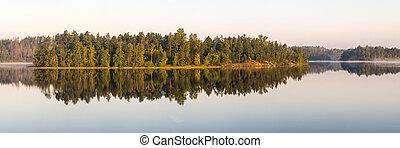 wooded island on lake