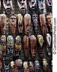 Wooden african masks hanging in a bazaar of Tunisia