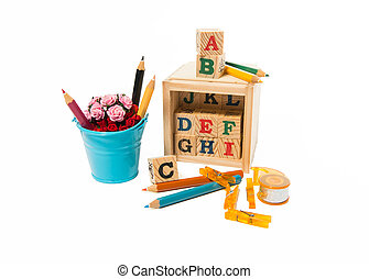 Wooden alphabet block with pencils