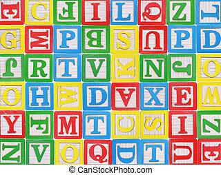 Wooden alphabet blocks background