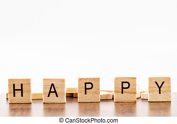 Wooden Alphabet Blocks spelling the word Happy