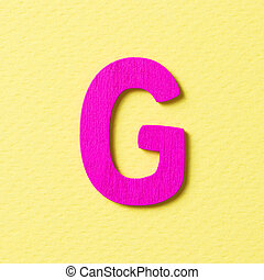 Wooden alphabet G in capital letter