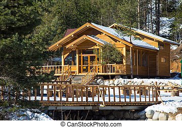 Wooden snow covered alpine chalet in the mountains