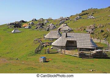 Wooden alpine huts - pastoral life, Slovenia - Wooden alpine...
