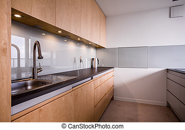 Wooden and neat kitchen in the flat