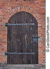 Wooden arch door with a lock