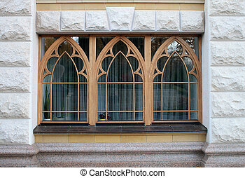 wooden arch windows of the stone house
