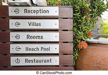 Wooden arrow sign post