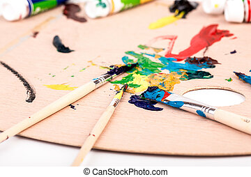 Wooden art palette with paint  brush on white background