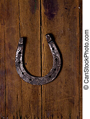 Wooden background and Horse Shoes