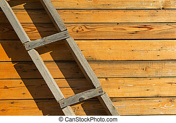 Wooden background. Homemade wooden staircase by the wall.