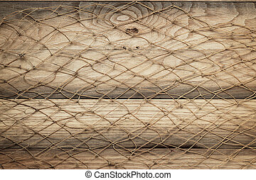 wooden background texture and fishing net on it