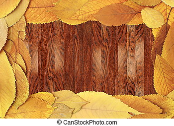 wooden background with cherry leaves