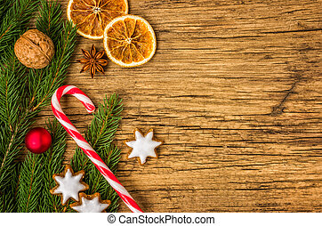 Wooden background with christmas decorations and copy space