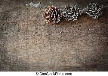 wooden background with cones