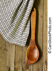 wooden background with empty spoon