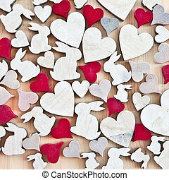 Wooden background with hearts and easter bunnies - Rustic...