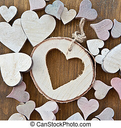 Wooden background with hearts