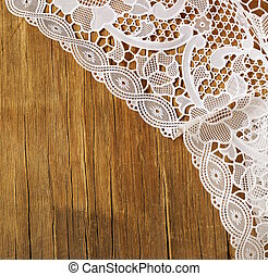 wooden background with lace napkin