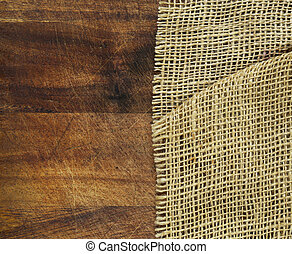 Wooden background with rough fabric burlap