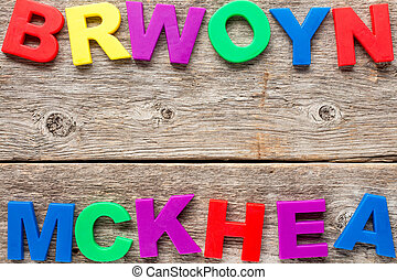 Wooden background with toy letters