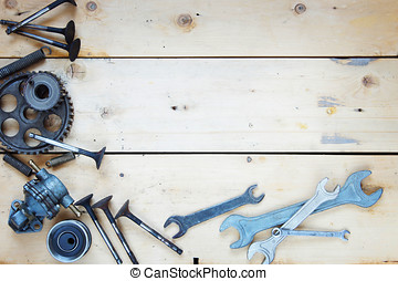 Wooden background with various automobile spare parts