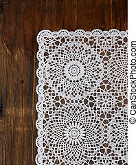 wooden background with white lace